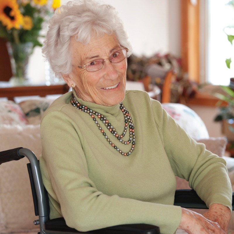 Senior woman smiling in wheelchair